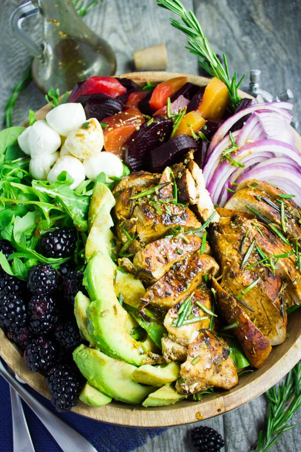 overhead shot of a Italian Balsamic Chicken Salad Recipe with blackberries, avocado, bocconcini and blackberry dressing