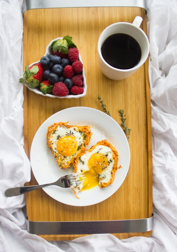 Baked Eggs in Sweet Potato Crust served on a breakfast tray with perfectly cooked yolks