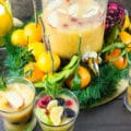 Fruity Non Alcoholic Sangria and Orange Salmon Bites Party. A super refreshing, replenishing Sangria that's fortified with a secret ingredient, plenty of fresh fruits and deliciousness! Parked with Orange Salmon Broccoli bites, plus get ideas for a warm cozy winter party with plenty of easy citrus centrepieces! www.twopurplefigs.com
