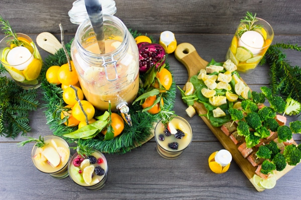 Fruity Non Alcoholic Sangria and Orange Salmon Bites festively arranged on a rustic table top