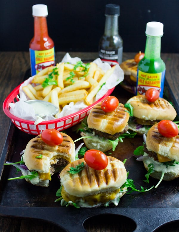 GameDay Habanero Mini Burgers. Absolutely delicious, crowd pleasing, habanero flavor packed mini burgers made in a snap with a few tricks! Get the step by step and make this your new Game Day favorite! www.twopurplefigs.com