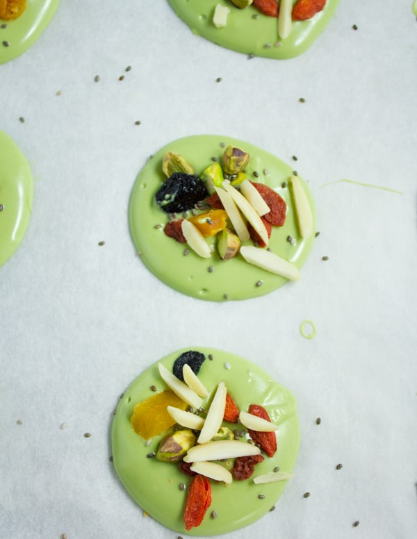 matcha white chocolate bark rounds topped with dried goji berries and nuts