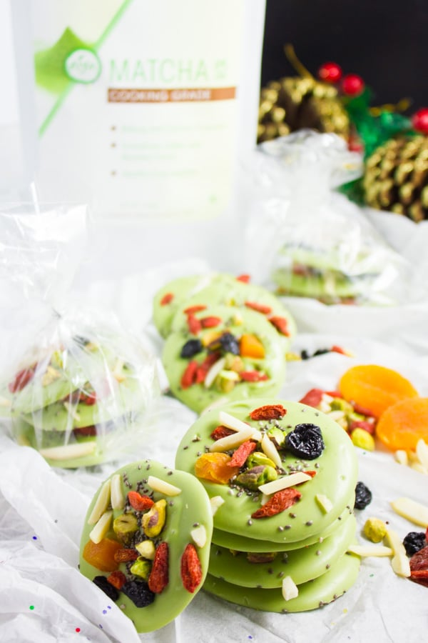 Superfood Matcha Green Tea Chocolate Bark rounds - some stacked, some wrapped as a present