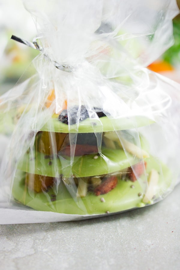 side view of a stack of Matcha Green Tea Chocolate Bark wrapped in transparent giftwrapper