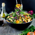 Sweet Persimmon Apple Kale Salad Recipe. Festive, rainbow goodness salad that's quick, light as air, crunchy, sweet and vegan. Dressed up with a sweet secret ingredient dressing! www.twopurplefigs.com