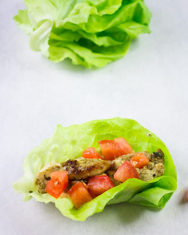 Chicken Shawarma Lettuce Cups with diced tomatoes on top