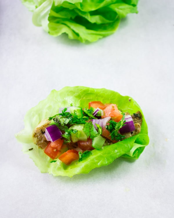 Chicken Shawarma in Lettuce Cups. Get the ultimate way to go healthy with a flavor packed succulent chicken shawarma served in lettuce cups. Hummus and all your favorite toppings included--a step by step recipe you need to make! www.twopurplefigs.com