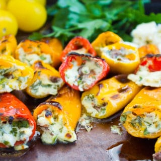 Mini Zesty Feta Stuffed Peppers. The freshest, easiest and quickest appetizer you'll ever make! Perfect for BBQ season or made in the broiler! Sweet, salty, spicy and utterly delicious. www.twopurplefigs.com