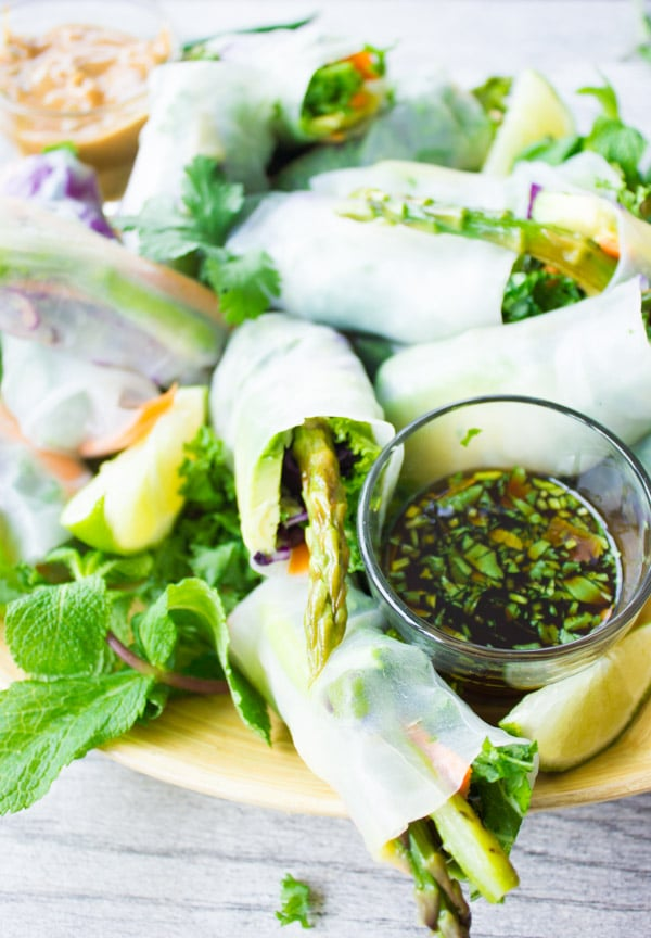 a plate of Summer Rolls with a small dish of chili cilantro dipping sauce on the side