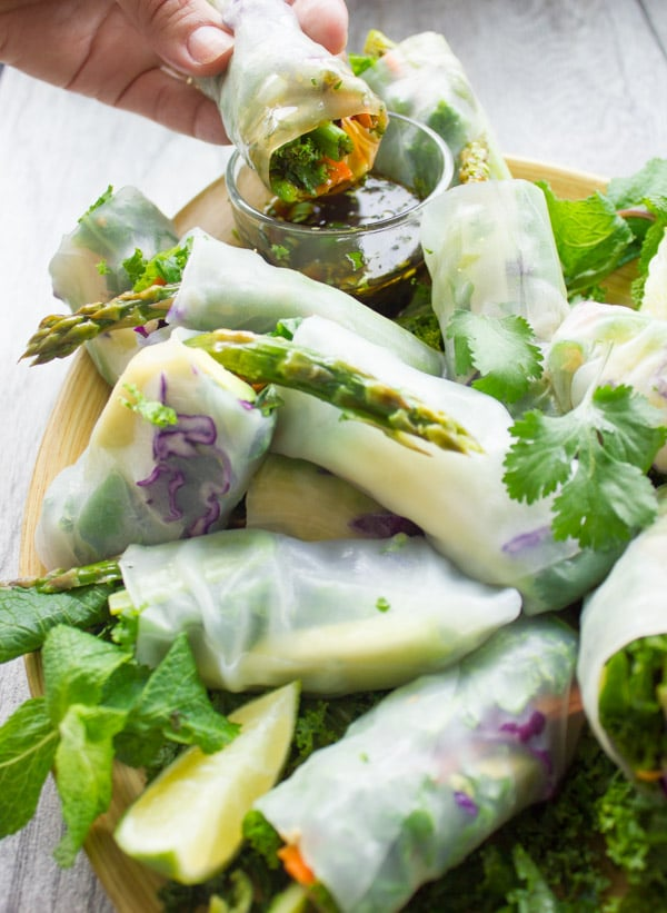 Summer Roll being dipped into a dish with cilantro dipping sauce