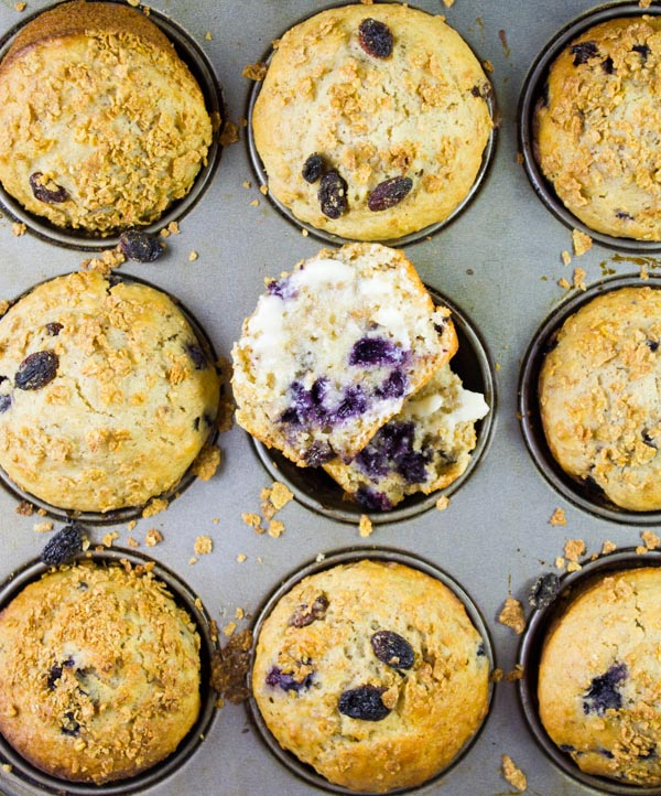 overhead shot of freshly baked Blueberry Raisin Bran Muffins in a muffin tin