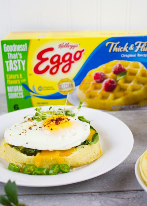 Cheesy Spinach Egg Breakfast Waffle. Easy, delicious and quick breakfast perfection that will WOW your friends and family--little ones and bigger ones! Get the step by step recipe now www.twopurplefigs.com