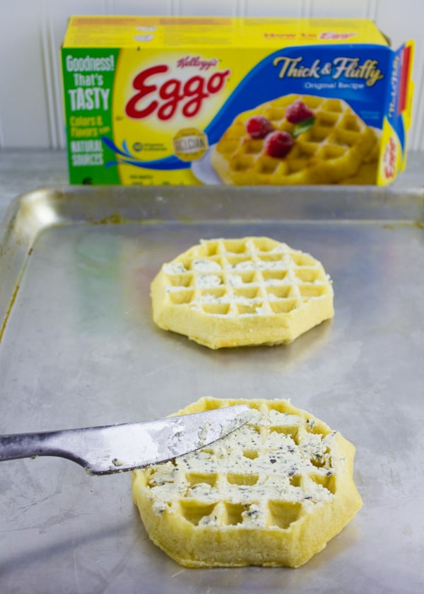 a EGGO breakfast waffle being spread with cream cheese