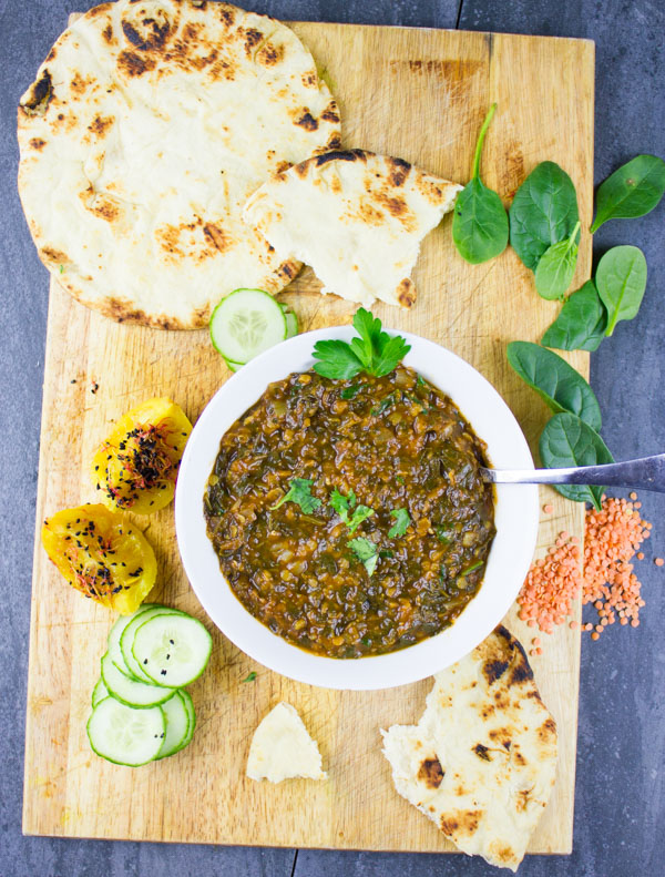 one pot meal of lentils and spinach. Heartwarming, delicious and the perfect way to have a heart vegetarian/vegan one pot meal! A must try classic North African dish recipe at www.twopurplefigs.com