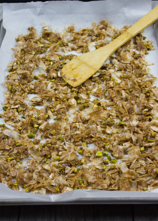 baklava crumbles ready to be baked on a baking sheet