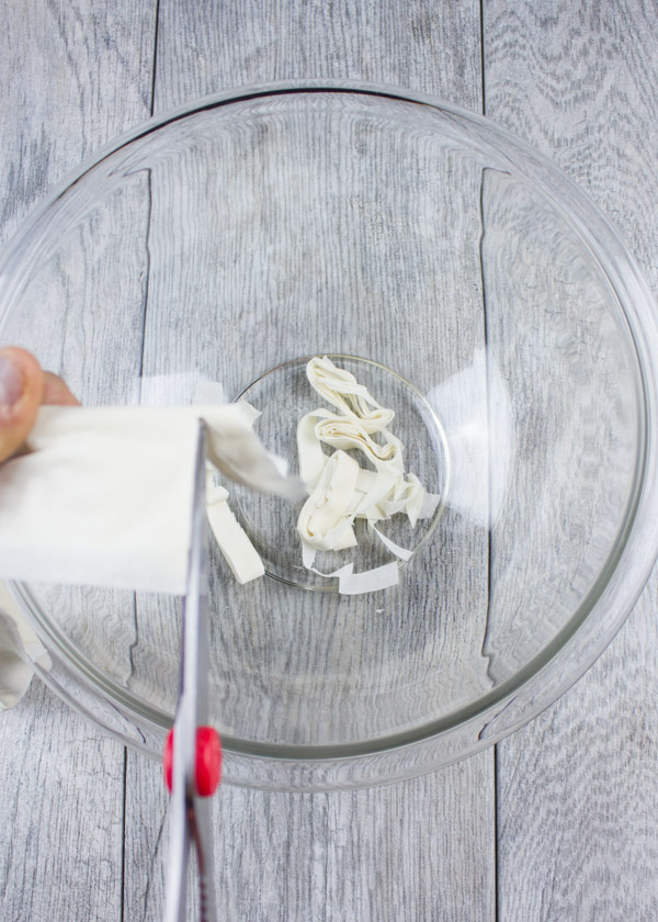 Filo Dough being cut into a glass bowl