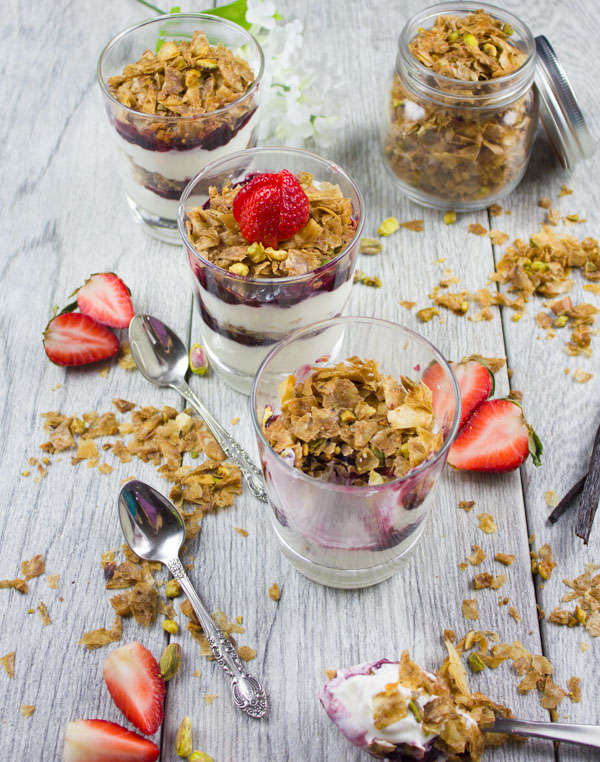 Baklava Yogurt Parfait with Homemade Baklava Crumbles served in glasses with fresh strawberries and some baklava crunch surrounding them