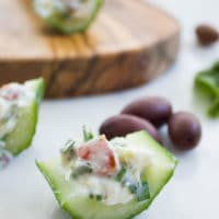 Best Feta Cucumber Salad Bites. The BEST appetizer to make this season! Your favorite Feta Cucumber Salad in Crunchy Bites! Recipe at www.twopurplefigs.com