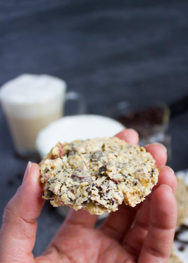 a hand holding a Coffee Bean Crunch Italian Cookies