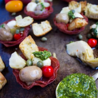 Antipasto In Bite Size Salami Cups. The BEST Antipasto you'll ever make! Recipe and Step by Step at www.twopurplefigs.com