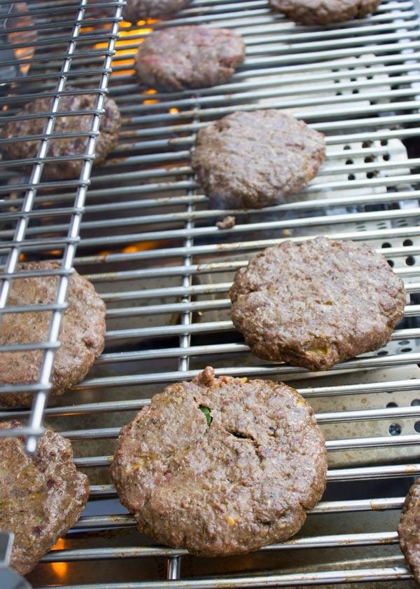 lamb burgers grilling on a bbq