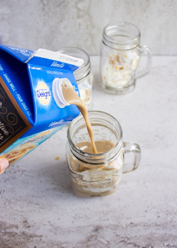 Tiramisu Iced Coffee Ice Cream Float. The most decadent summer dessert you'll make in minutes! www.twopurplefigs.com
