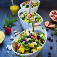 Fruity Greek Salad With Sweet Mango Salad Dressing. This is absolutely my FAVORITE salad recipe! Fresh sweet summer fruits with tangy feta in a sweet Mango Greek Salad Dressing! Summer heaven! www.twopurplefigs.com