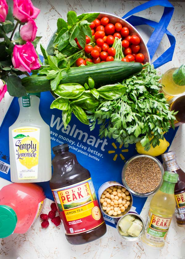 Ingredients for Mediterranean Farro Salad with Sweet Zesty Lemonade Dressing piled up on a Walmart bag.
