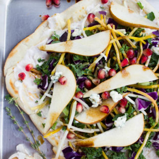 Veggie Pizza On the Grill with Garlic Blue Cheese Sauce. Perfect pizza grilled, spread with garlic blue cheese sauce topped with a crispy kale beet blend, sweet pears, crumbles of blue cheese and a drizzle of balsamic! Super easy and quick yet totally gourmet! recipe and tips at www.twopurplefigs.com