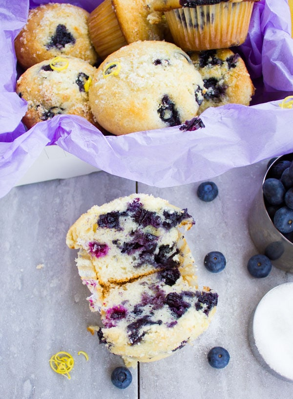 Blueberry Muffins With Lemon Sugar Crunch. Tender and light as air blueberry muffins spiked with a lemon sugar crunch! This will remind you of your grandma's blueberry muffins! www.twopurplefigs.com
