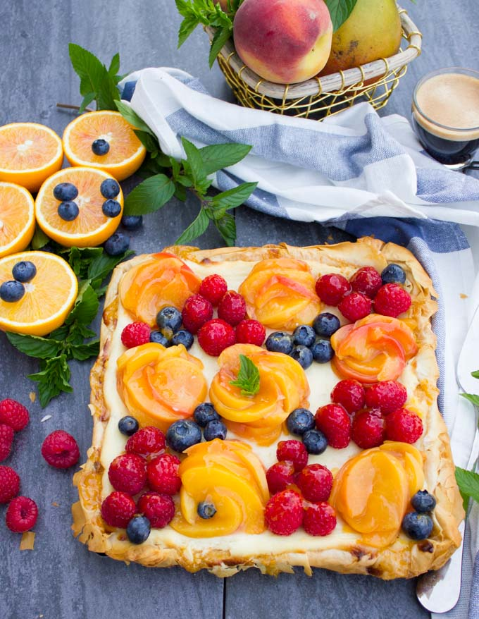 Peach Orange Mango and Ricotta Tart with Phyllo Dough. Baking has never been so easy, divine, creamy and fruity! Perfect for entertaining, this tart is an all time favorite and very forgiving! recipe: www.twopurplefigs.com