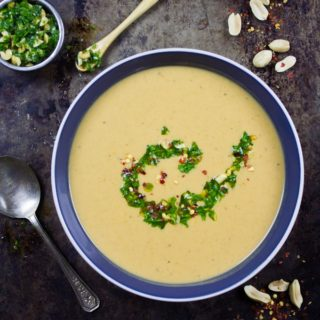 Creamy Peanut Soup with Peanut Crunch Herb Pistou. Authentic African recipe that my family picked up a long time ago, and we've been making/sharing it since then! It's pure peanut LOVE in every sip! www.twopurplefigs.com