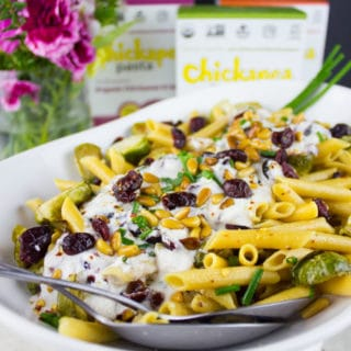 Holiday Turkish Pasta With Yogurt Sauce. This pasta dish is a HIT at every party because of the creamy, tangy and refreshing yogurt sauce! It's spiked with garlic, herbs, Brussel sprouts and sweet cranberries for the Holidays! Recipe and Video at www.twopurplefigs.com #ad #ChooseChickapea