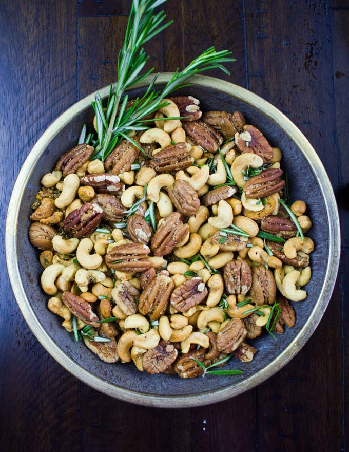 Rosemary Spiced Candied Pecans and Cashews in a small metal bowl
