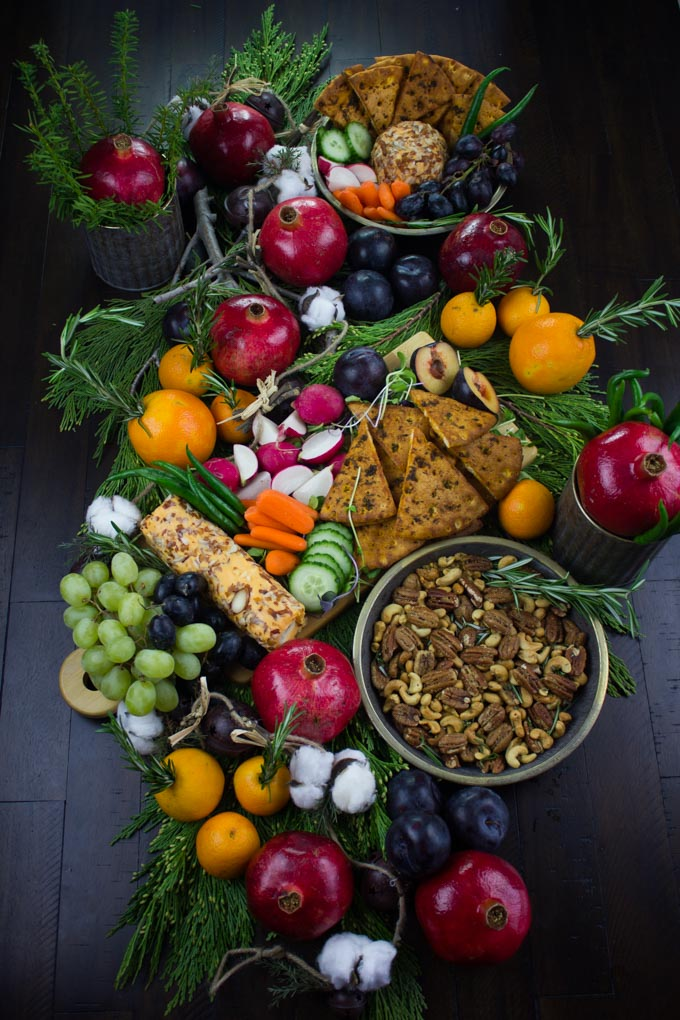 a festive display of winter fruit, Rosemary Spiced Candied Pecans and Pita Chips arranged for a Cheese Party