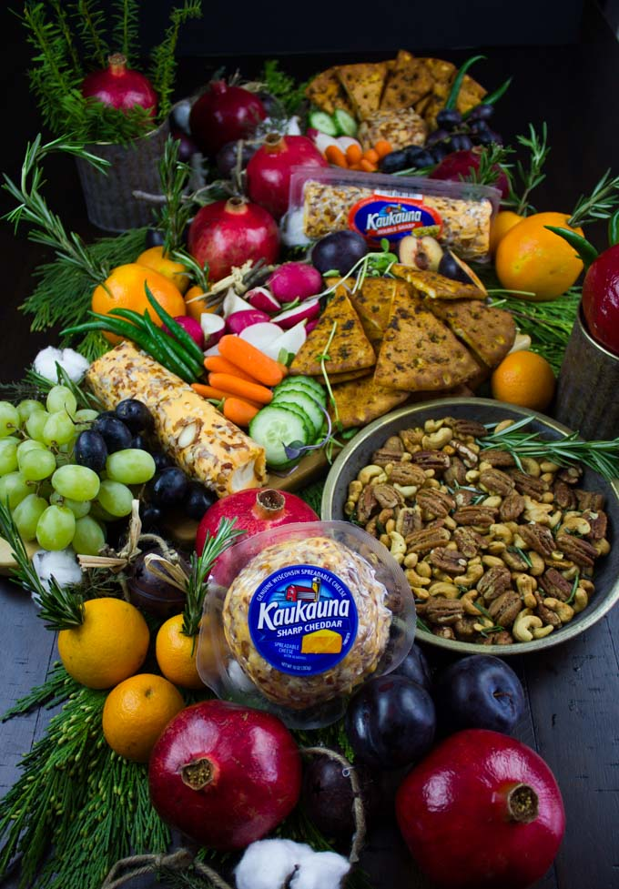 a feast if Rosemary Spiced Candied Pecans and Pita Chips arranged with seasonal fruit for A Cheese Party.