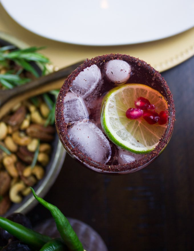 overhead shot of a glass of pomegranate mocktail with sumac dusted rim
