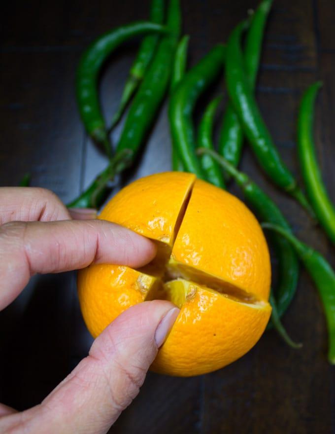 an orange being split open to create a fruit centerpiece