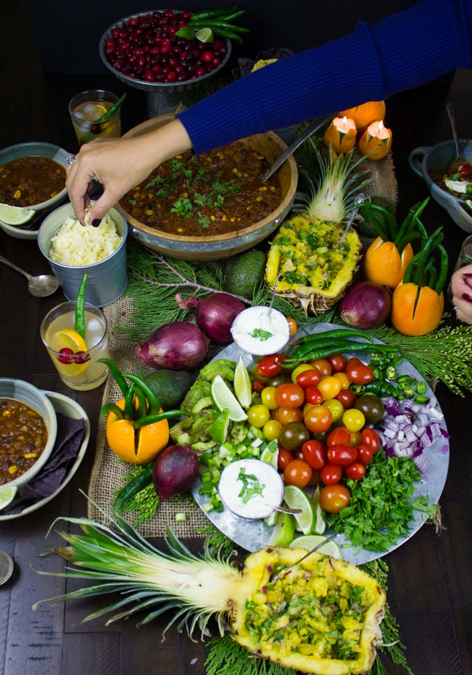 a chili bar with homemade vegetarian chili, pineapple salsa and a veggie platter