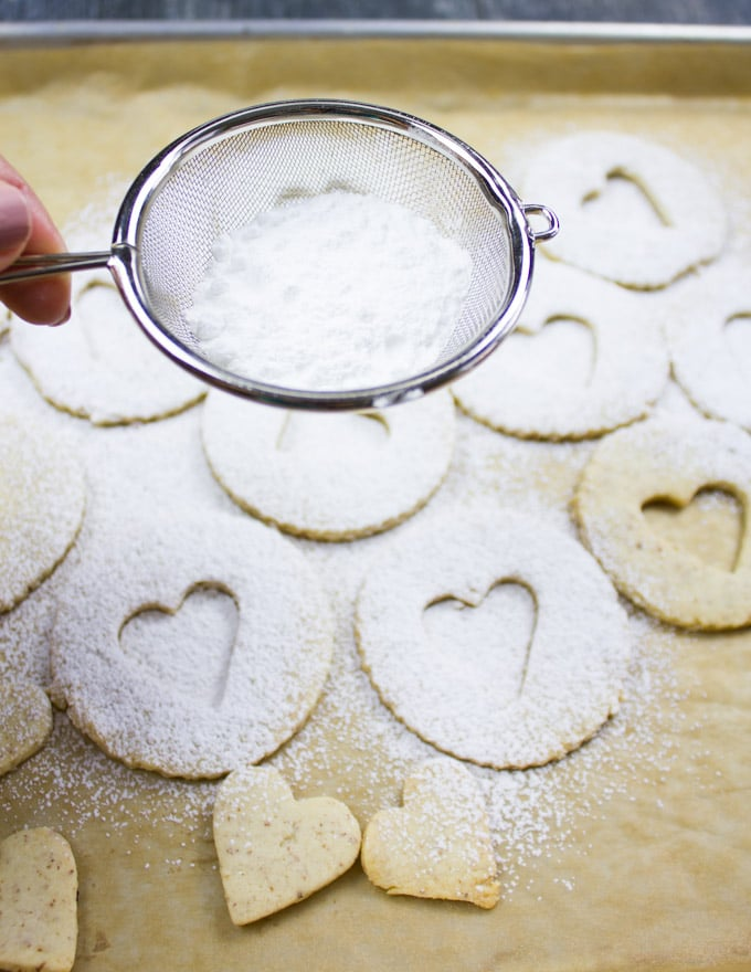 Holiday Maple Linzer Cookies. This delicious twist on a delicious cookie is the BEST! Bake a huge batch of these, they disappear fast! www.twopurplefigs.com