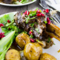 Pomegranate Roast Lamb Shanks. Easy delicious comfort food! Only four ingredients including homemade pomegranate molasses is all you need for a delicious feast like this! Recipe at www.twopurplefigs.com