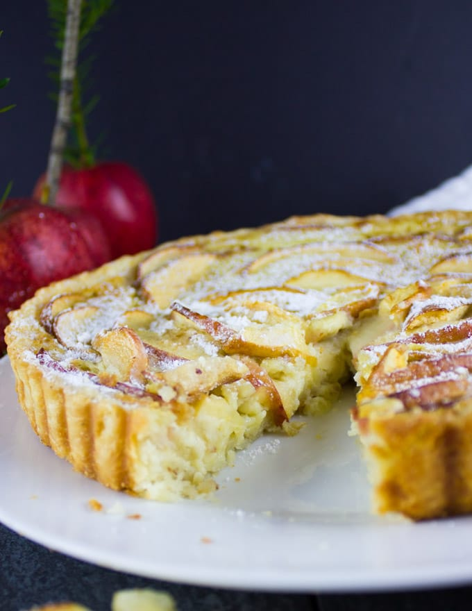 close up of Swiss Apple Tart with gala apples in the background