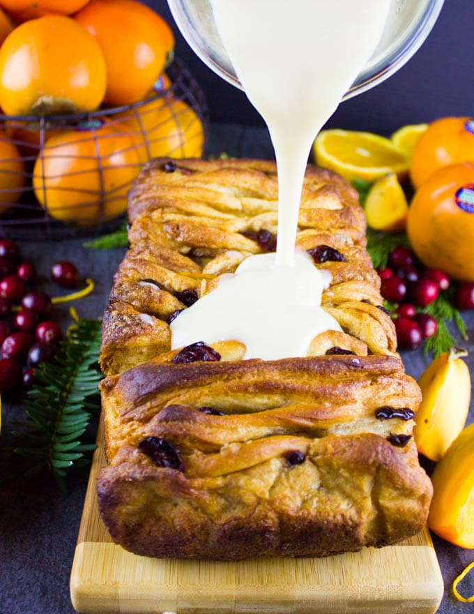 persiMon® Orange Cinnamon Pull Apart Bread. This sweet, festive and ,melt in your moust buttery, cinnamon-y, fruity bread is perfect to share! Easy, sweet and totally worth every bite! Recipe and step by step | www.twopurplefigs.com