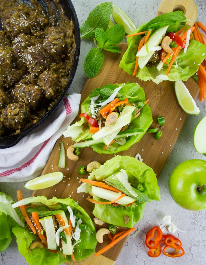 overhead shot of Thai Chicken Meatballs lettuce wraps with Apple Peanut Sauce