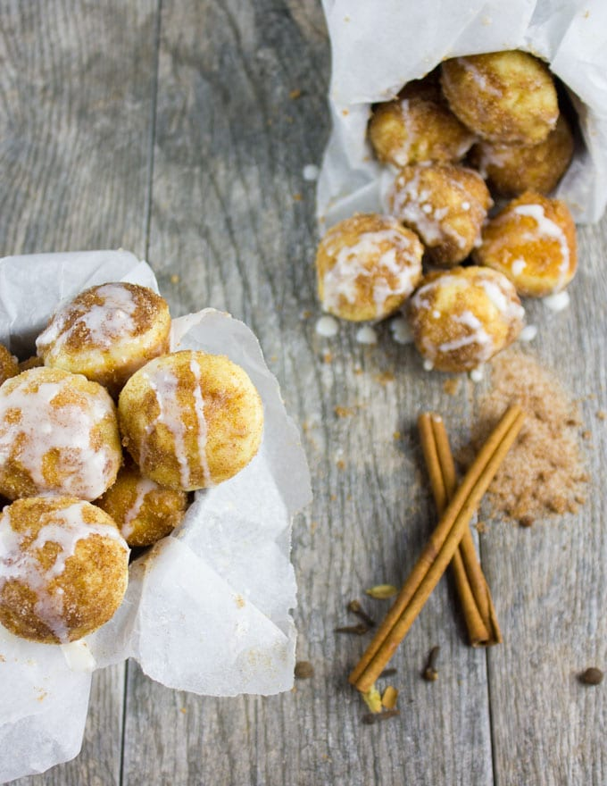 Baked Donut Holes with Cinnamon Sugar and Vanilla Glaze. The quickest most divine way to enjoy some donut comfort!