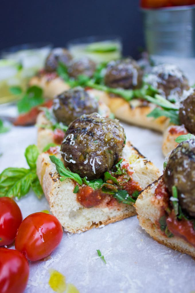 American Lamb Meatball Subs with marinara sauce and basil cut into bite-sized pieced