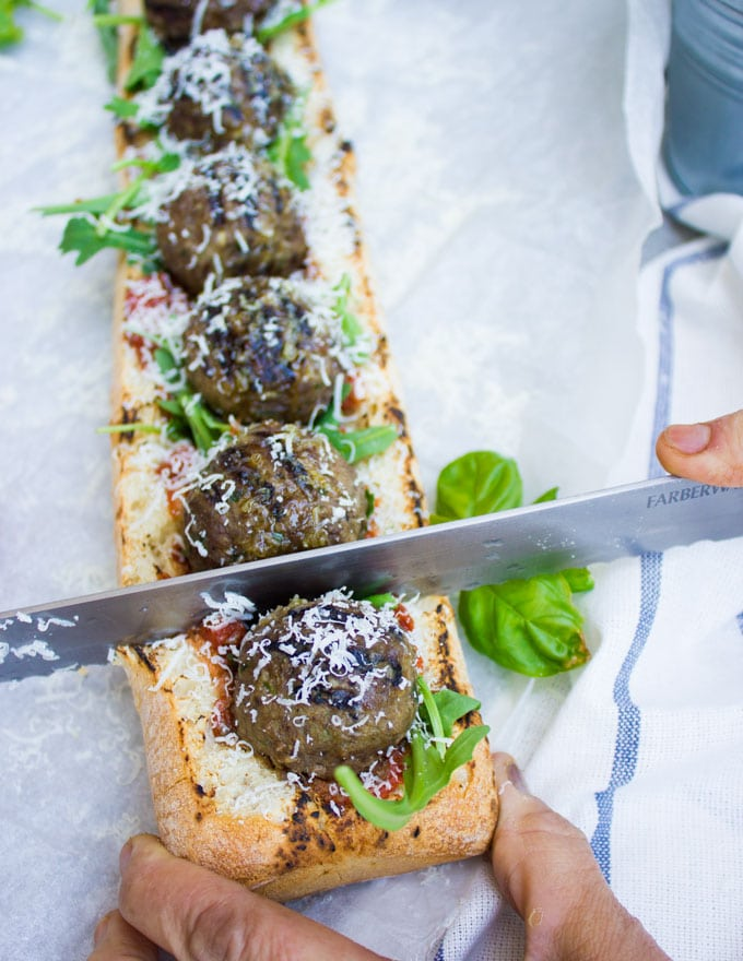 American Lamb Meatball Sub being cut into pieces