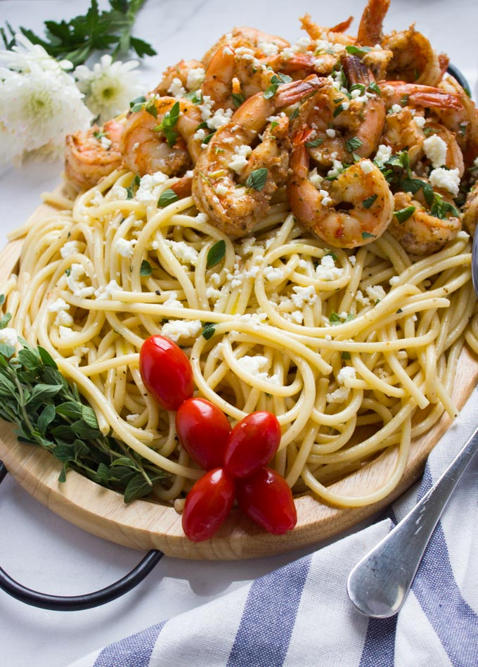 Quick Shrimp Pasta with Garlic Feta Sauce. 15 Minute pasta dish that's light, delicious, easy and loaded with a Mediterranean flare!