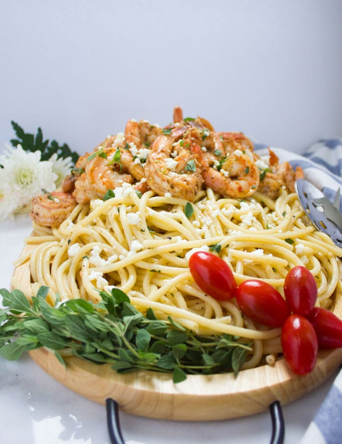 side-view of Quick Shrimp Pasta with Garlic Feta Sauce served on a wooden platter