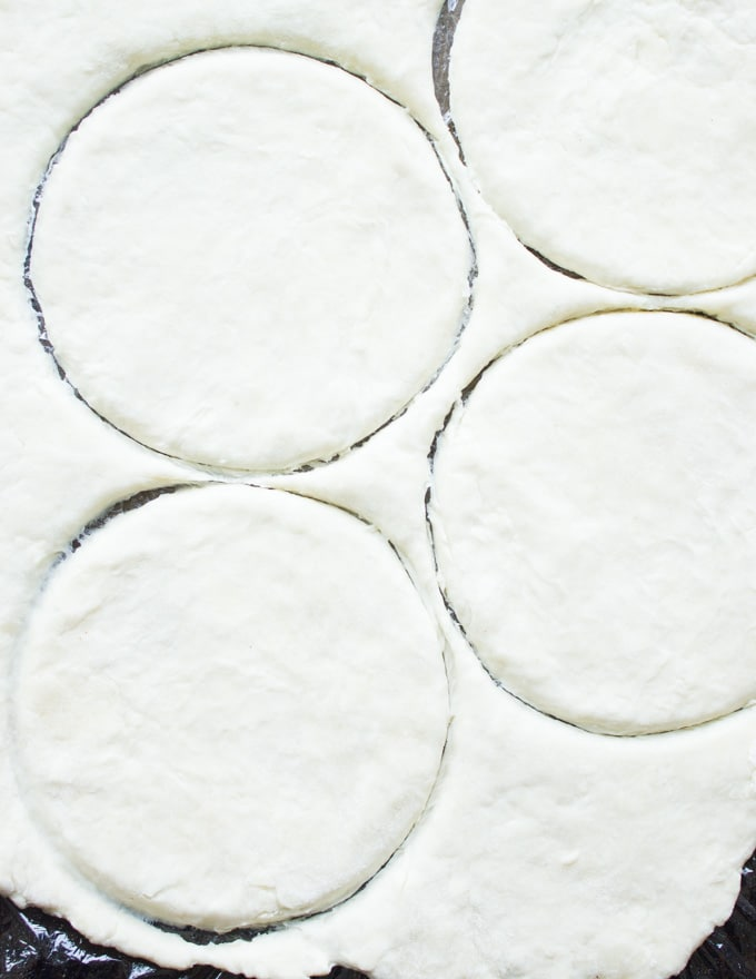 rounds being cut out of pie pastry